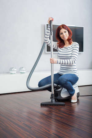 lowboard: Attractive Female with Vacuum in Living Room