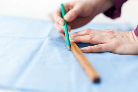 metering: Metering tissue with a wooden dip stick Stock Photo