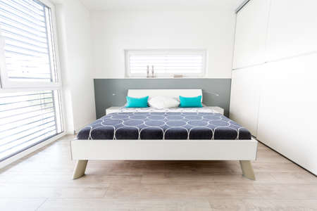 Modern Mster Bedroom with large Window and wooden floor