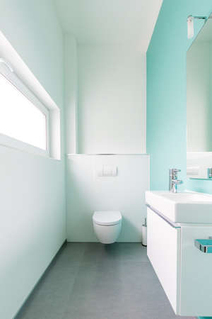 turqoise: Modern guest toilet in a family home Stock Photo