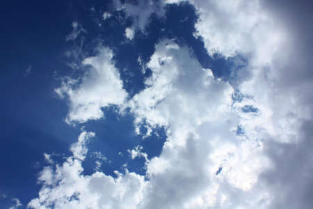 Cloud during noon gives bright cloud formation. Sun rays pass thick cloud. Stock Photo