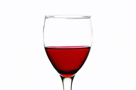 白地に赤ワインのガラス 写真素材