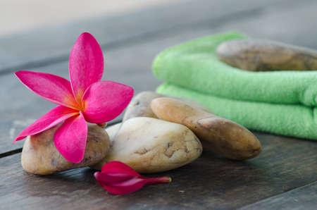 frangipani flower and Fabric with stone photo