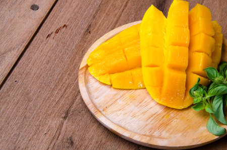 mango slice: mango slice on wood background Stock Photo