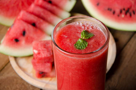 fruits juice: Watermelon smoothie on wood background and healthy for you.