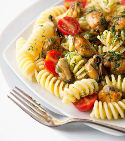 Italian fusilli pasta with musells, tomatoes and herbs Stock Photo