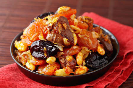 Moroccan tajine with dry fruits, honey and almonds