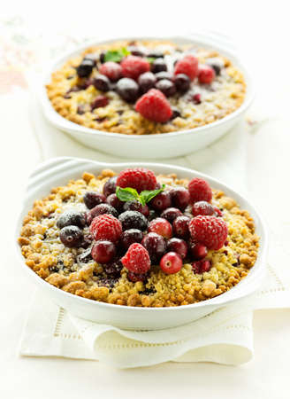 Crispy berry crumble on the table Stock Photo
