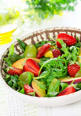 Fruit salad with strawberry and rucola Stock Photo