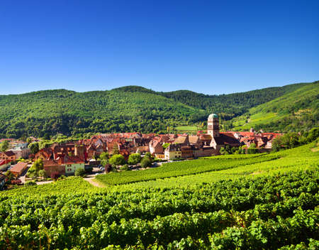 Kaysersberg village and Vosges mountains in the backgroung Stock Photo