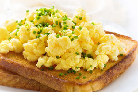 scramble: Breakfast with scrambled eggs and  toasts Stock Photo