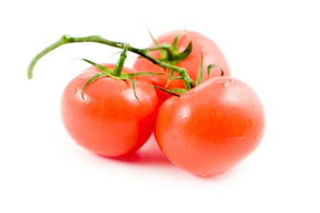 3 tomatos with drops Stock Photo