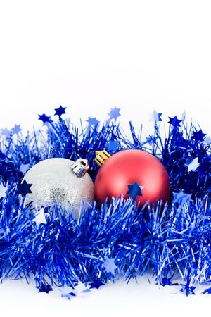 christmas red and silver balls in an environment of  a blue tinsel vertical frame photo
