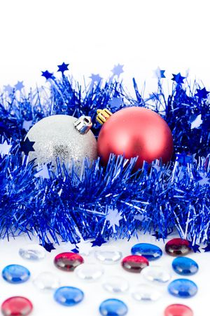 christmas colored balls in an environment of  a blue tinsel vertical frame with marbles photo