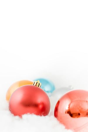 christmas colored balls in an environment of  a blue white clouds vertical frame photo