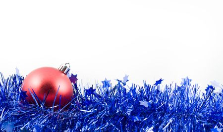 christmas red ball in an environment of  a tinsel on a white background