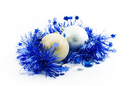 christmas gold and silver balls s in an environment of  a tinsel and marbles on a white background photo