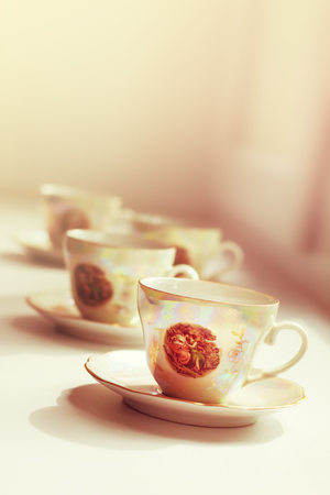 pearl tea: pearl antique tea cup on blurred background