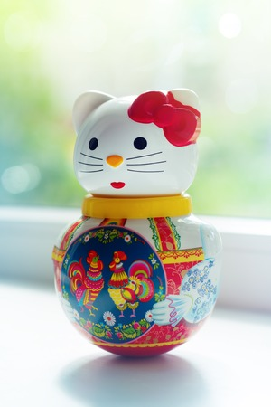 a doll lucky cat in home interior Stok Fotoğraf