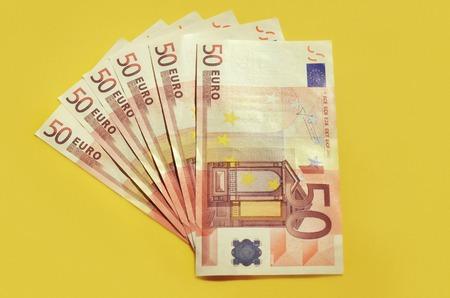 50 euro: Euro money banknotes. 50 euro yellow background
