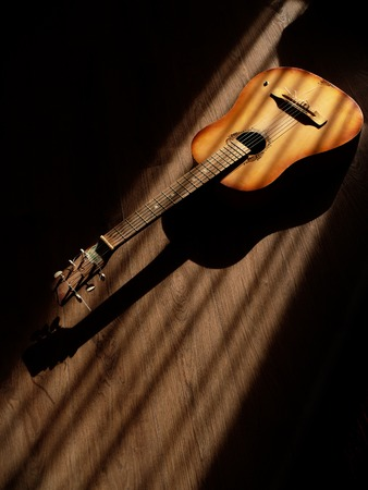 Classical guitar on wooden background long shadows Stok Fotoğraf