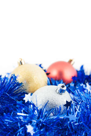 Christmas balls and tinsel isolated white background