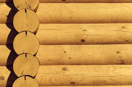 Natural background pattern of a log wall closeup