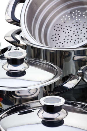 A fragment of a still life of chrome-plated pans Stock Photo