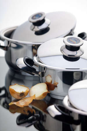 chromeplated: A fragment of a still life of chrome-plated pans Stock Photo