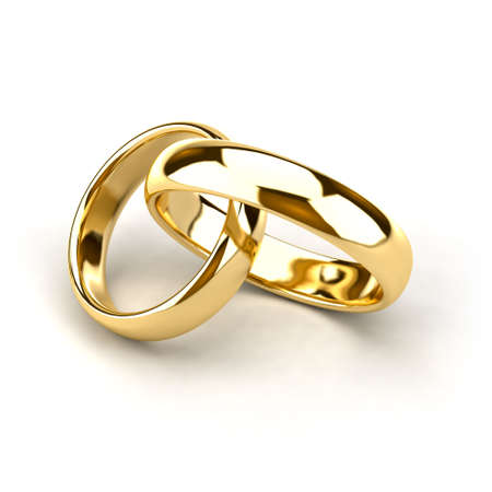 interconnected: Two wedding rings, like links in the chain are interconnected Stock Photo