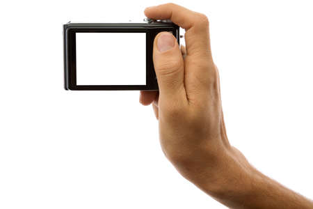 Hand of a man holding a digital camera on a white background photo