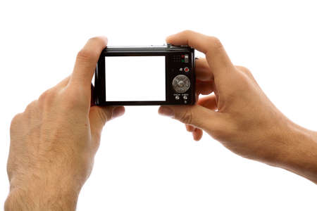 Hands of a man holding a digital camera on a white background photo