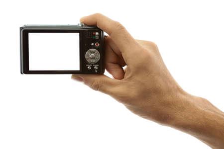 viewfinder: Mano di un uomo in possesso di una fotocamera digitale su uno sfondo bianco
