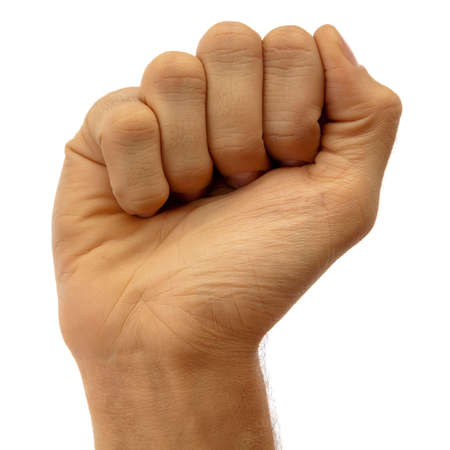 closed fist sign: Fist clenched fingers, mans hand is raised. On a white background.