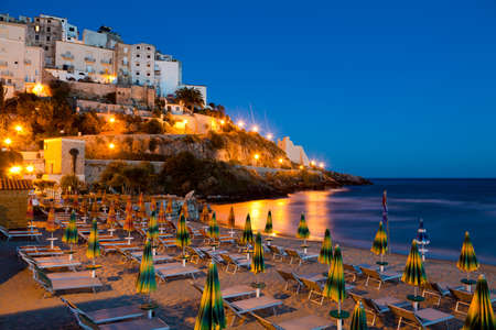Evening view of the beach and the rock on which the beautiful Italian city of Sperlonga Stock Photo