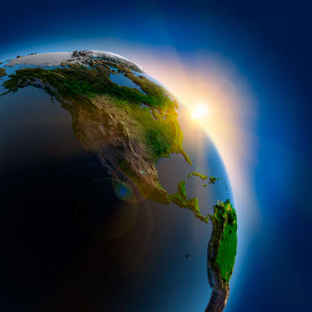 elevation: The suns rays from the rising sun illuminate the earth in outer space