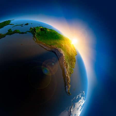 america del sur: Los rayos del sol desde el sol naciente iluminan la tierra en el espacio ultraterrestre