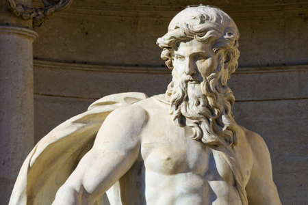 Close up of the Neptune statue of the Trevi Fountain in Rome, Italy
