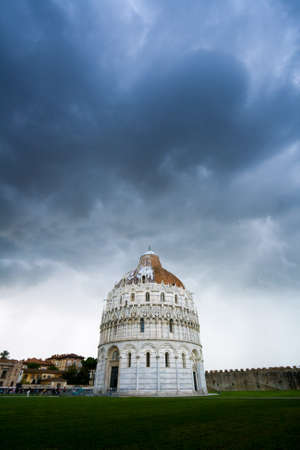 Heavy leaden cloud over an architectural monument photo