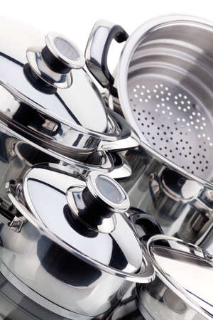 cookware: Set of chrome plated aluminum cookware - pots, pans, shot in studio on a white background Stock Photo