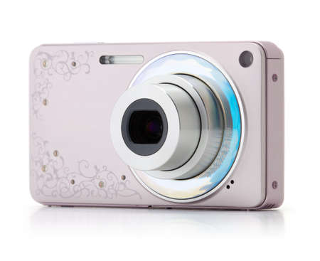 Pink digital compact camera on a white background photo