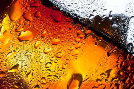 temperance: Dew drops on the glass cup with whiskey