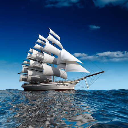 Sailing ship in the vast ocean with small waves is getting all the sails filled with sea breeze Stock Photo