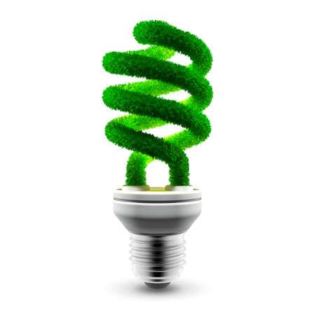 energie: Konzeptionelle Energiesparlampe - Glas-Spiralschlauch ist mit grünem Gras bedeckt.