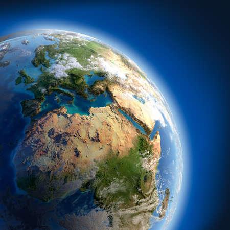 Un fragmento de la Tierra con alto relieve, la superficie detallada, translúcido, y la atmósfera, iluminada por la luz del sol Foto de archivo