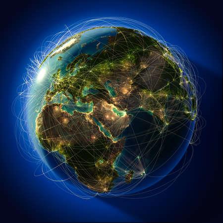 negocios internacionales: El planeta Tierra altamente detallado en la noche, iluminada desde atr�s del sol de la tarde, con los continentes en relieve, iluminados por la luz de las ciudades, transl�cidos y el oc�ano reflexivo. La Tierra est� rodeada por una red luminosa, en representaci�n de las principales rutas a�reas basadas en la verdadera
