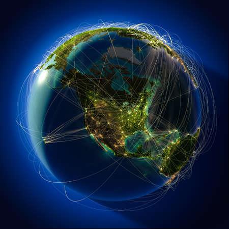 El planeta Tierra altamente detallado en la noche, iluminada desde atrás del sol de la tarde, con los continentes en relieve, iluminados por la luz de las ciudades, translúcidos y el océano reflexivo. La Tierra está rodeada por una red luminosa, en representación de las principales rutas aéreas basadas en la verdadera