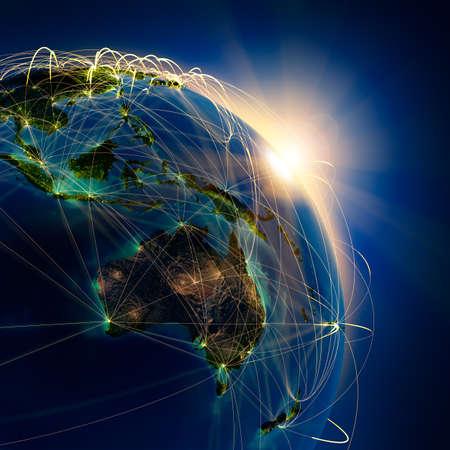 conexiones: El planeta Tierra altamente detallado en la noche, iluminada por el sol naciente, con los continentes en relieve, iluminados por la luz de las ciudades, transl�cidos y el oc�ano reflexivo. La Tierra est� rodeada por una red luminosa, en representaci�n de las principales rutas a�reas basadas en datos reales Foto de archivo