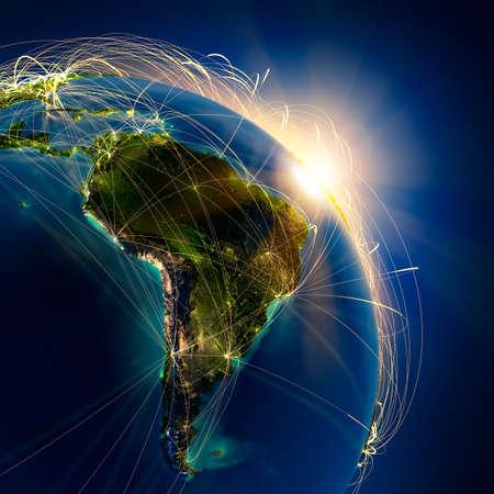 sol naciente: El planeta Tierra altamente detallado en la noche, iluminada por el sol naciente, con los continentes en relieve, iluminados por la luz de las ciudades, transl�cidos y el oc�ano reflexivo. La Tierra est� rodeada por una red luminosa, en representaci�n de las principales rutas a�reas basadas en datos reales Foto de archivo