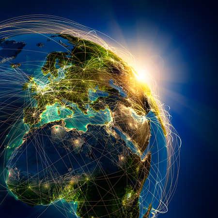 mapa de africa: El planeta Tierra altamente detallado en la noche, iluminada por el sol naciente, con los continentes en relieve, iluminados por la luz de las ciudades, translúcidos y el océano reflexivo. La Tierra está rodeada por una red luminosa, en representación de las principales rutas aéreas basadas en datos reales Foto de archivo